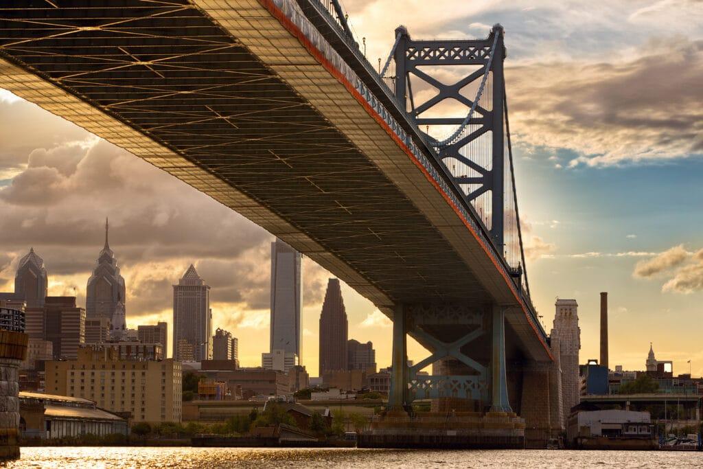 Philadelphia skyline and Ben Franklin Bridge at sunset, US
