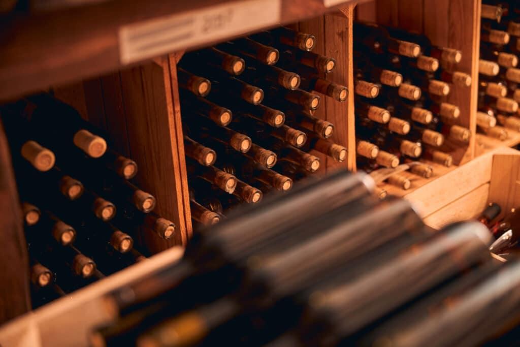 Storage room with bottles of wine  in wooden racks