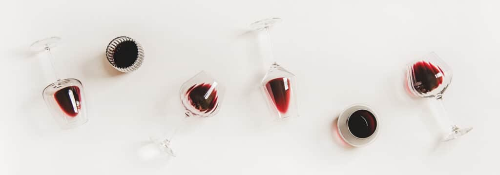 Red wine in glasses. Flat-lay of wine glasses with Beaujolais