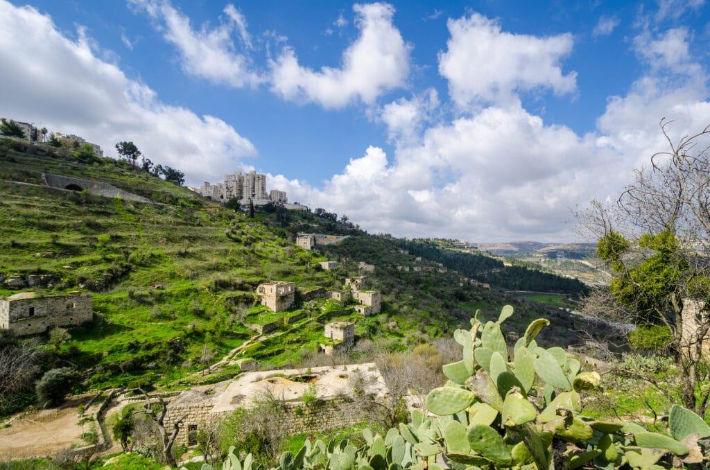 Lifta, Jerusalem, Israel is an abandoned village, juxtaposed against new high rises.