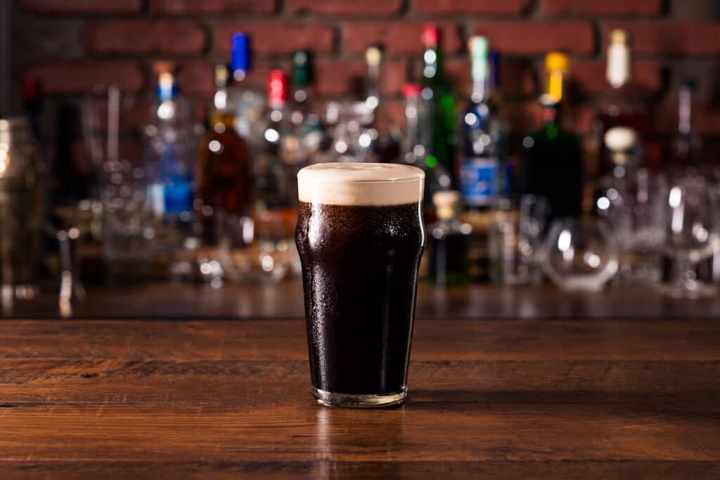 Refreshing Dark Stout Craft Beer on a Bar