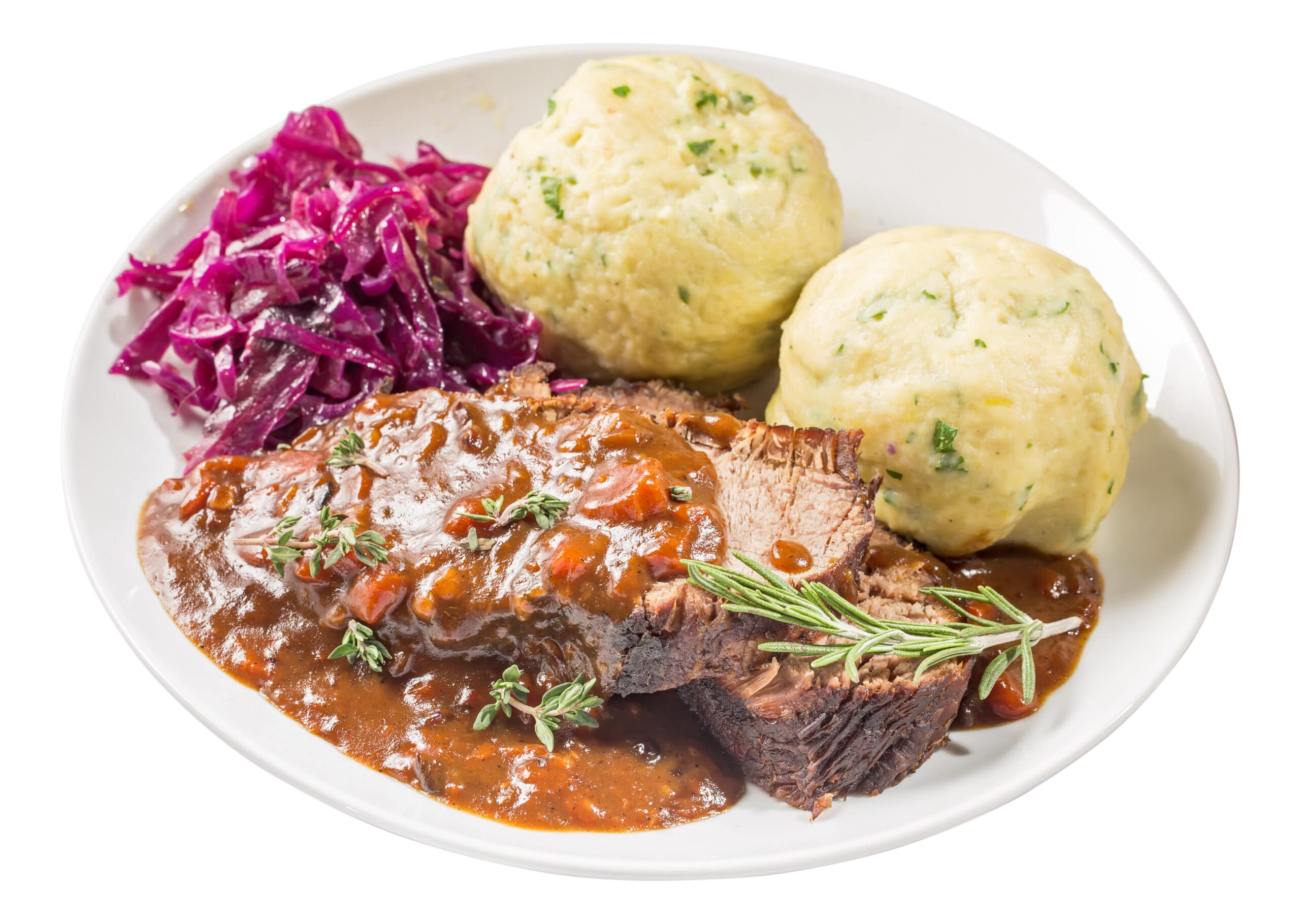 German stewed beef meat with red cabbage and potato dumpling, isolated. Sauerbraten