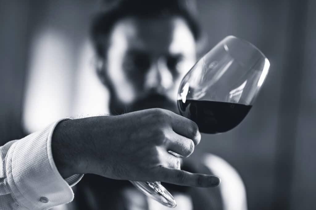 Sommelier tasting red wine