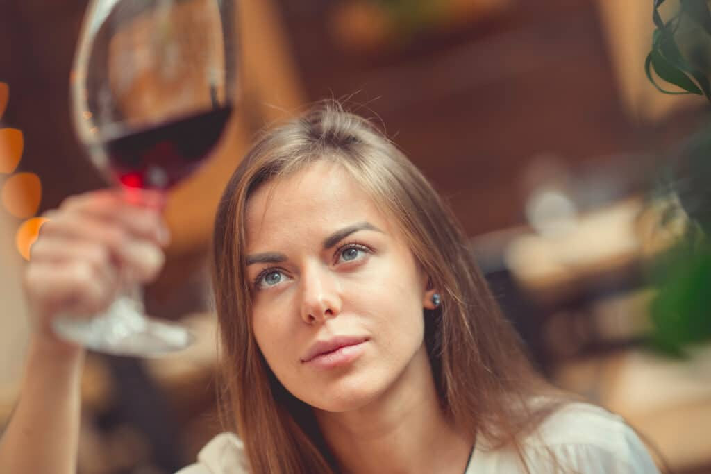 Young girl with a glass indoors