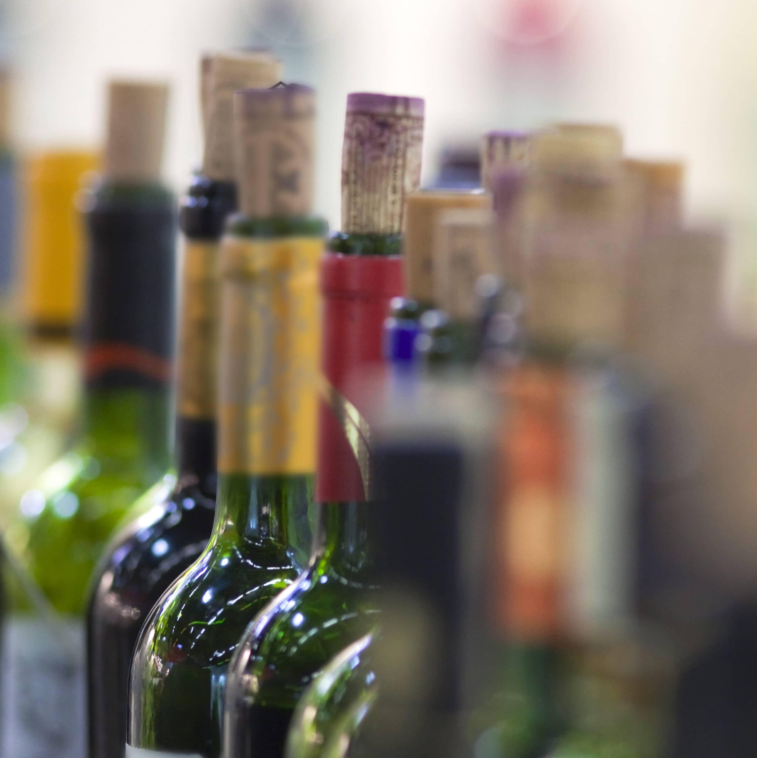Bottle of red wine in a winery near Bordeaux, France